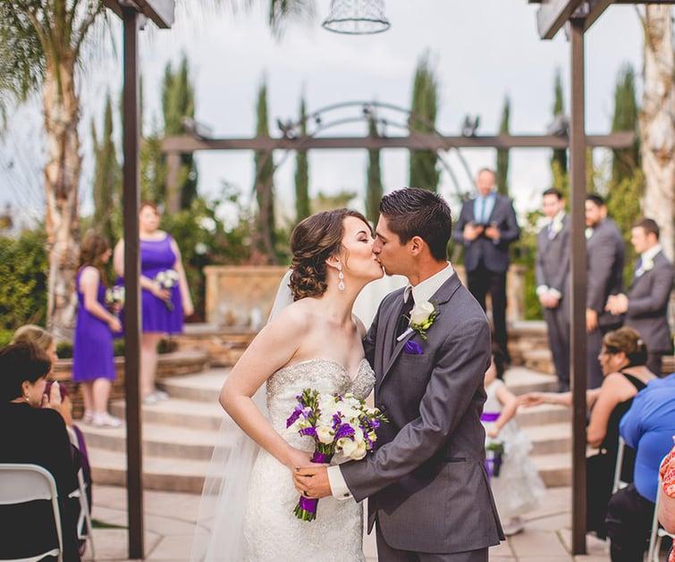Wedding Ceremony Kiss | Fresno Fields by Wedgewood Weddings