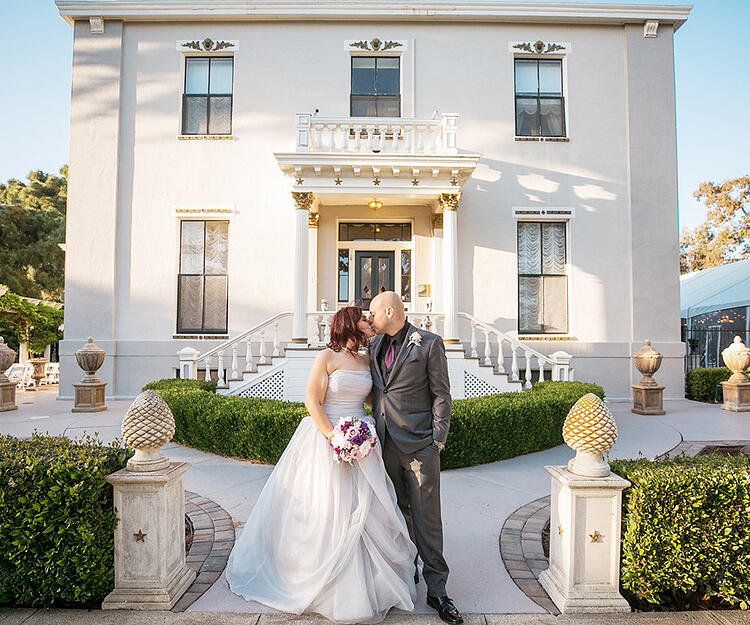 Through manicured hedges and an Italian-style colonnade, step inside the magnificent grandeur of this American Colonial estate. - Jefferson St Mansion by Wedgewood Weddings