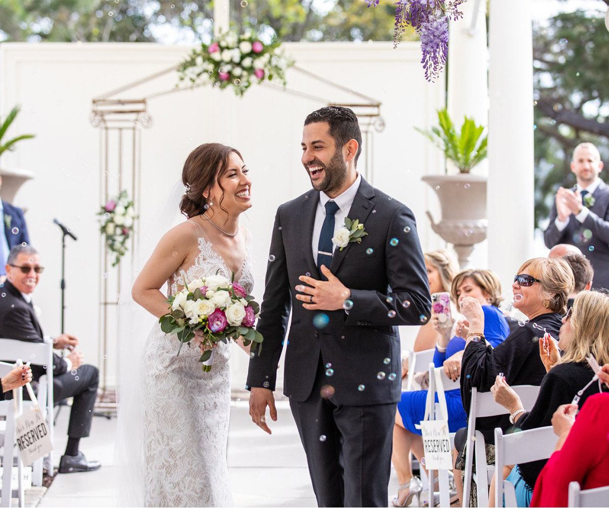 Take advantage of the endless photo opportunities featuring a wisteria-draped veranda, glimmering bay waters, and the meticulously-designed surroundings of the stunning historic mansion - Jefferson St Mansion by Wedgewood Weddings