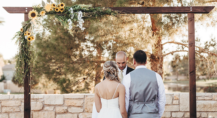 A Couple Exchange Vows In Front Of Their Officiant At Ocotillo Oasis By Wedgewood Weddings