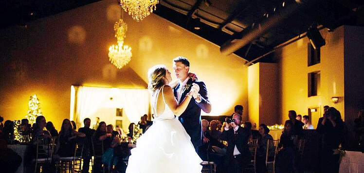 CUSTOM LIGHTING CAN MAKE FOR A DRAMATIC FIRST DANCE WEDDING PHOTO