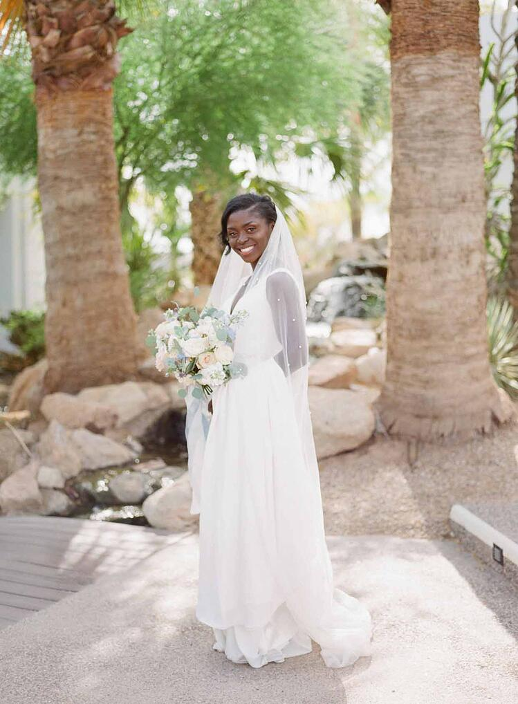 Enyo Looked Stunning In A Simple White Wedding Gown With Pearl-Accented Belt and Veil