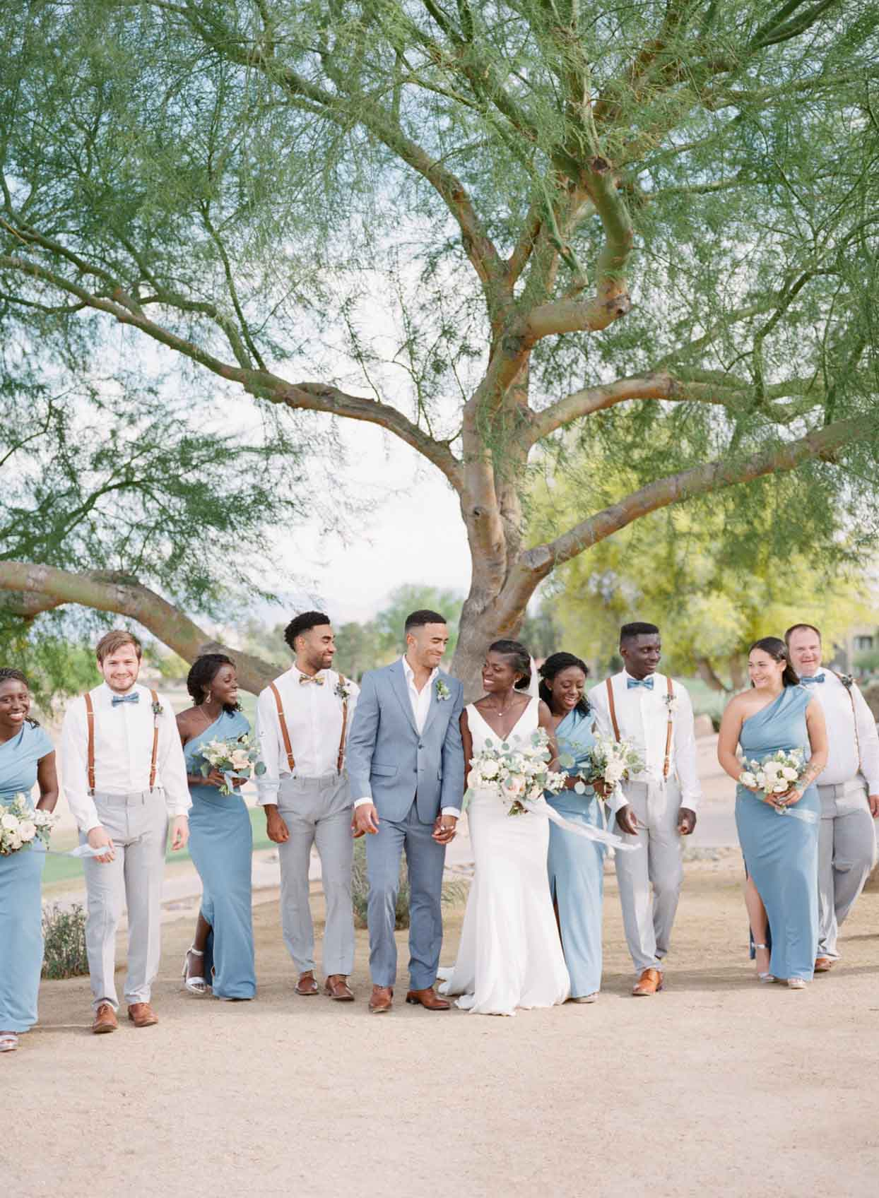 Charming Wedding Party Walks Across The Desert Grounds at Palm Valley in Goodyear, AZ