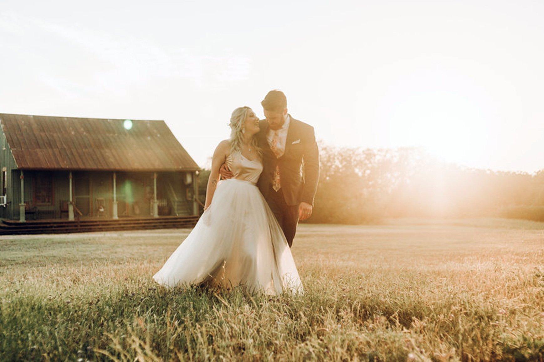 Newlyweds outside of Hofmann Ranch in Castroville, TX