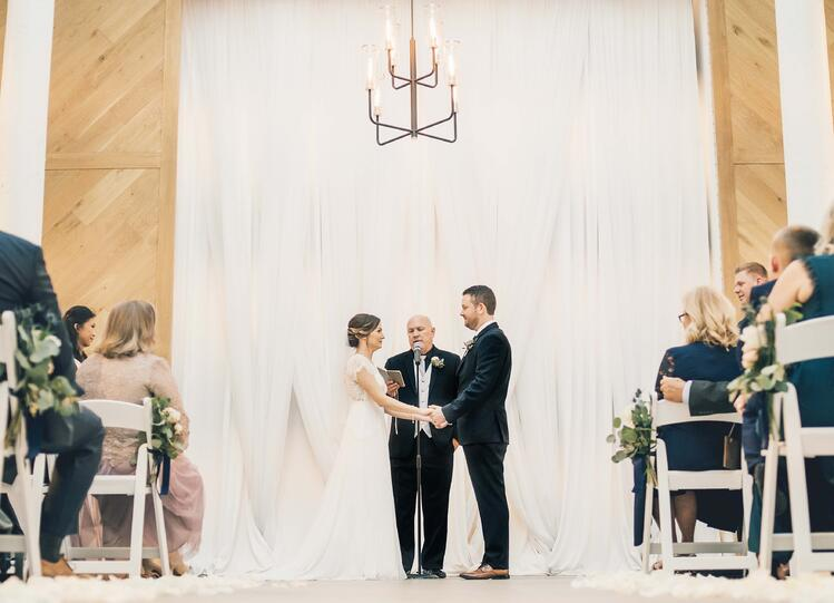 the heartfelt vows echoed perfectly in the stunning modern cathedral | The Carlsbad Windmill | Focus On Love Photography