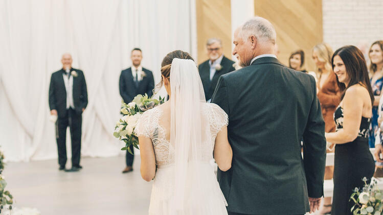 Jamie walks down the aisle full of loved ones with her dear father | The Carlsbad Windmill | Focus On Love Photography