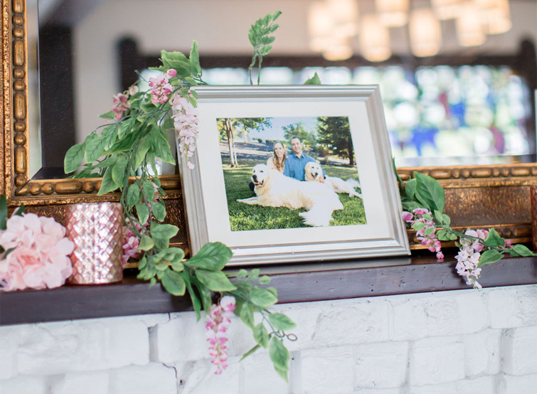 Julie & Vince's family portraits have pride of place on the mantel at Sequoia Mansion, CA