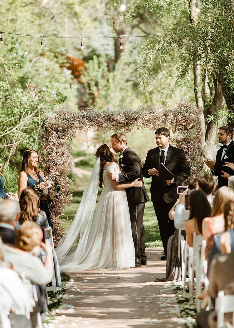 What do you envision when you imagine a romantic celebration of love in the woods alongside a babbling creek? Chances are it'll look something like this beautiful wedding at Boulder Creek by Wedgewood Weddings. Think secret-garden vibes, romantic nature-inspired color palette, lavish greenery, roses, and wandering wildlife. Oh, and dinosaurs! Join us for a virtual tour of Katie and Robert's wedding story . . .