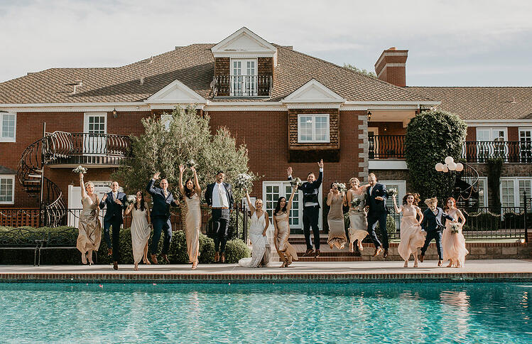 These playful jumping photos in front of the manor's pool turned out priceless