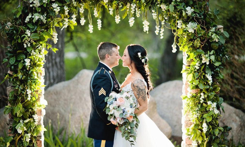 Bride & Groom Under Floral Arch at Boulder Creek by Wedgewood Weddings