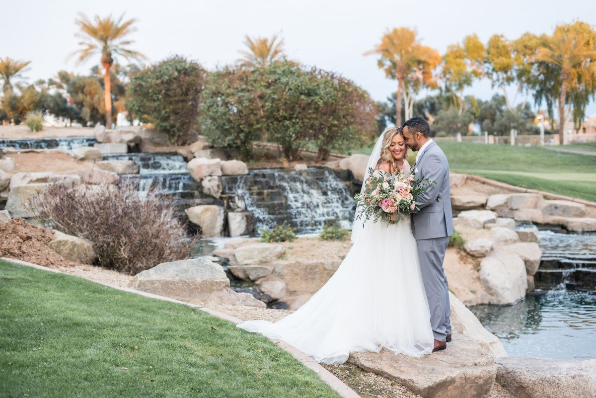 Newlyweds Pose By Waterfall at Ocotillo Oasis