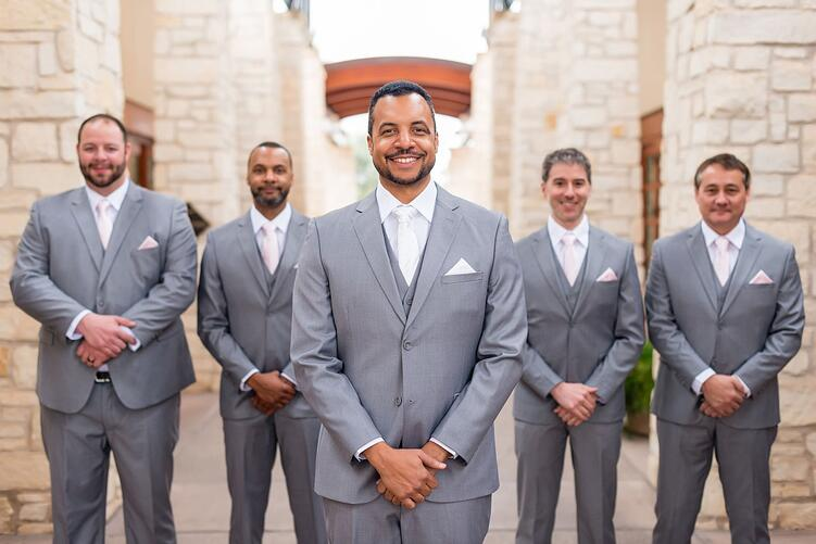 dapper groomsmen in grey tuxedos at Ocotillo Oasis in Chandler Arizona