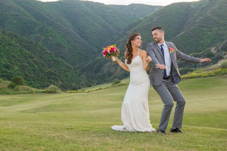 Happy newlyweds celebrate their wedding at The Retreat by Wedgewood Weddings