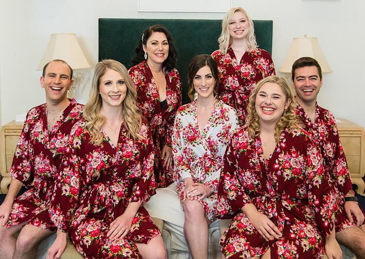 a bridal party wearing matching get-ready robes before the wedding