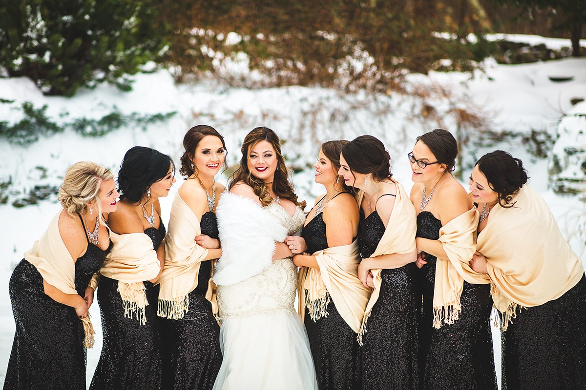 A bridal party in the snow during a winter New England wedding at Granite Rose