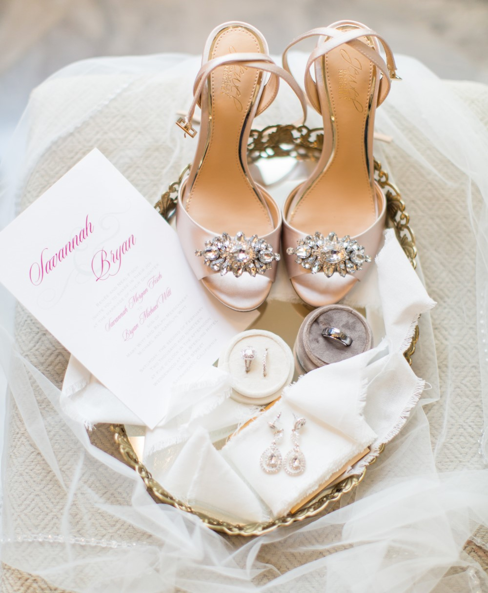 wedding invite, bridal shoes, wedding rings, and accessories
