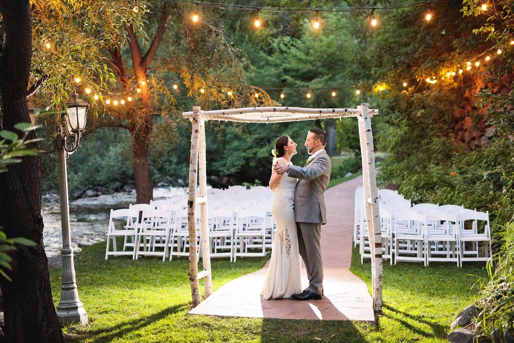 An outdoor wedding underneath the bistro lights at Boulder Creek in Colorado
