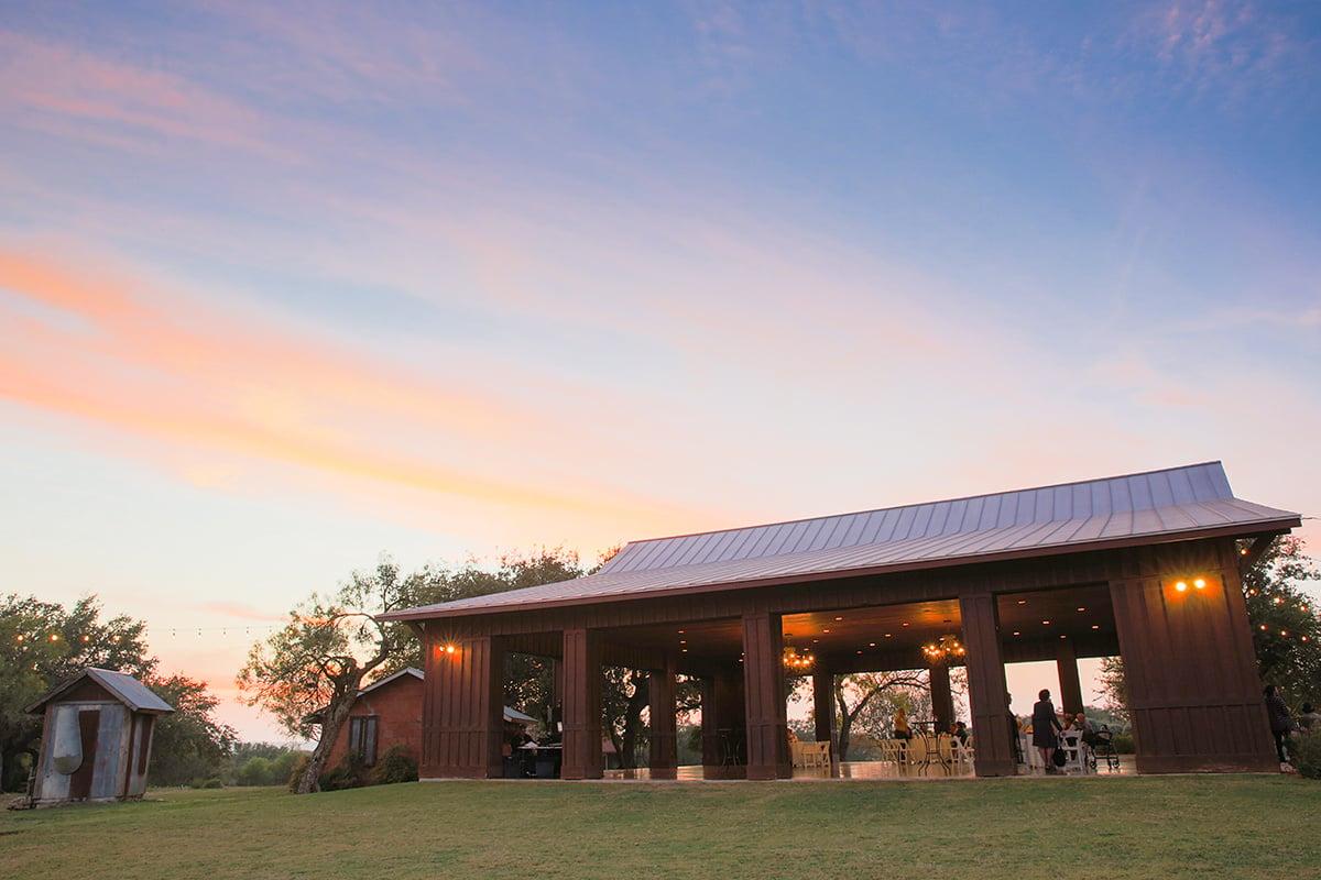 A sunset outdoor wedding in Texas at Hofmann Ranch
