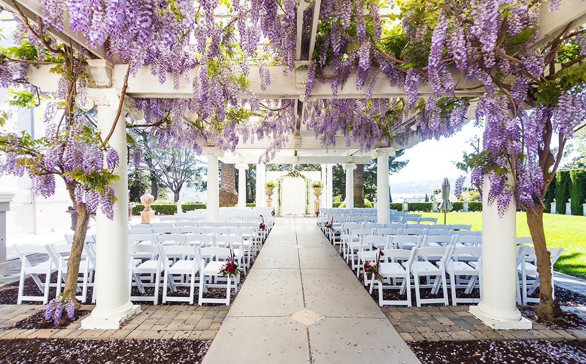 Jefferson Street Mansion is an outdoor wedding venue with a wisteria-draped veranda for wedding ceremonies