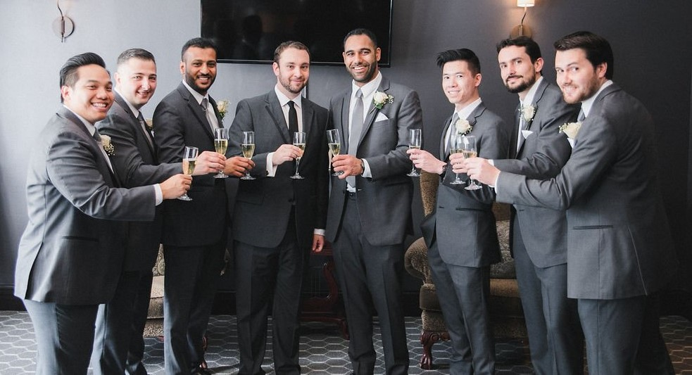 The groom's party celebrate with a champagne toast