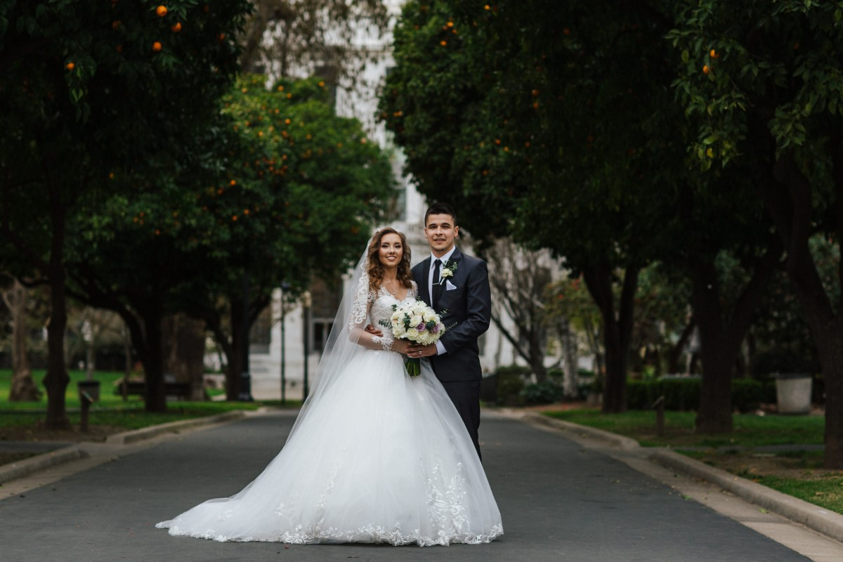 Newlyweds smile for a wedding portrait in Downtown Sacramento
