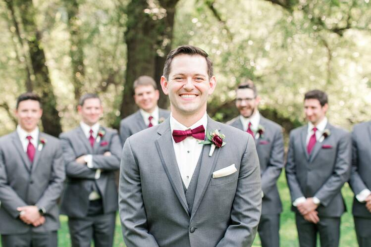 Handsome groom with maroon bowtie at Boulder Creek