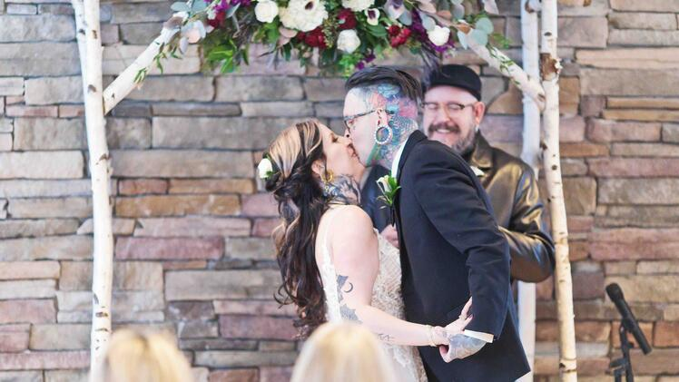 Romantic First Kiss at Boulder Creek Winter Wedding