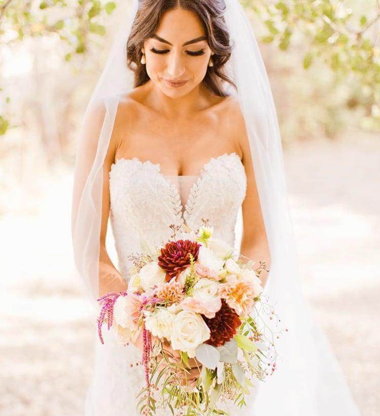 Stunning Bride With Cascading Garden Style Wedding Bouquet
