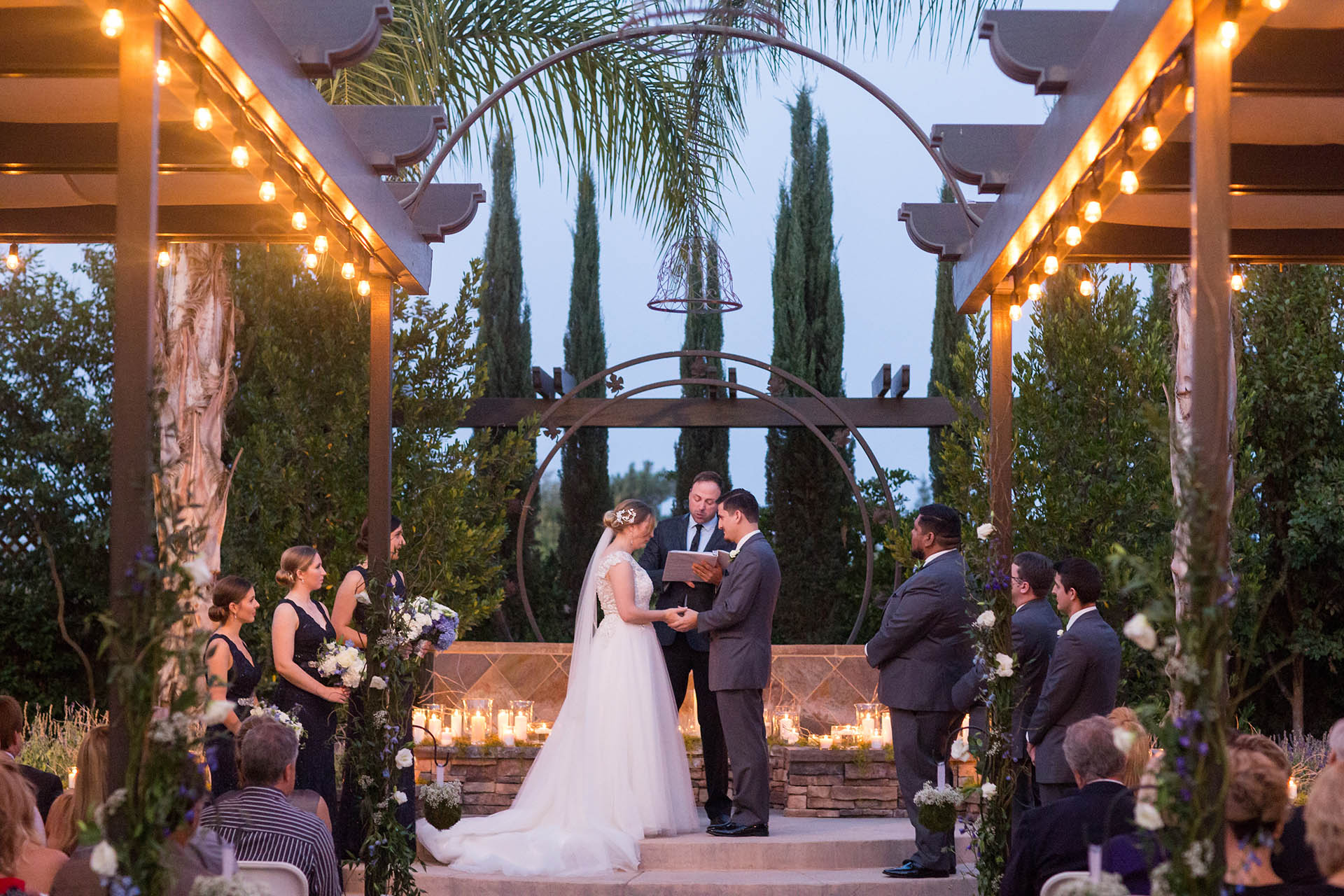 Romantic lighting during a golden hour wedding ceremony