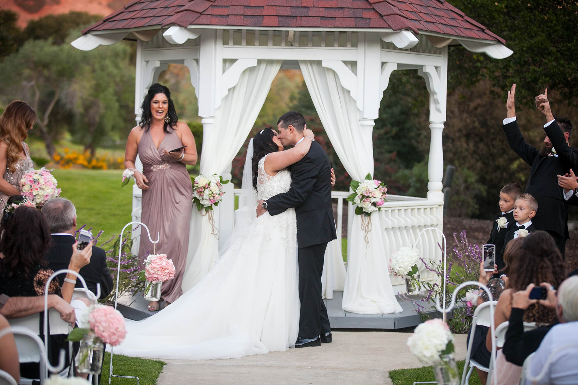 Garden ceremony with traditional gazebo