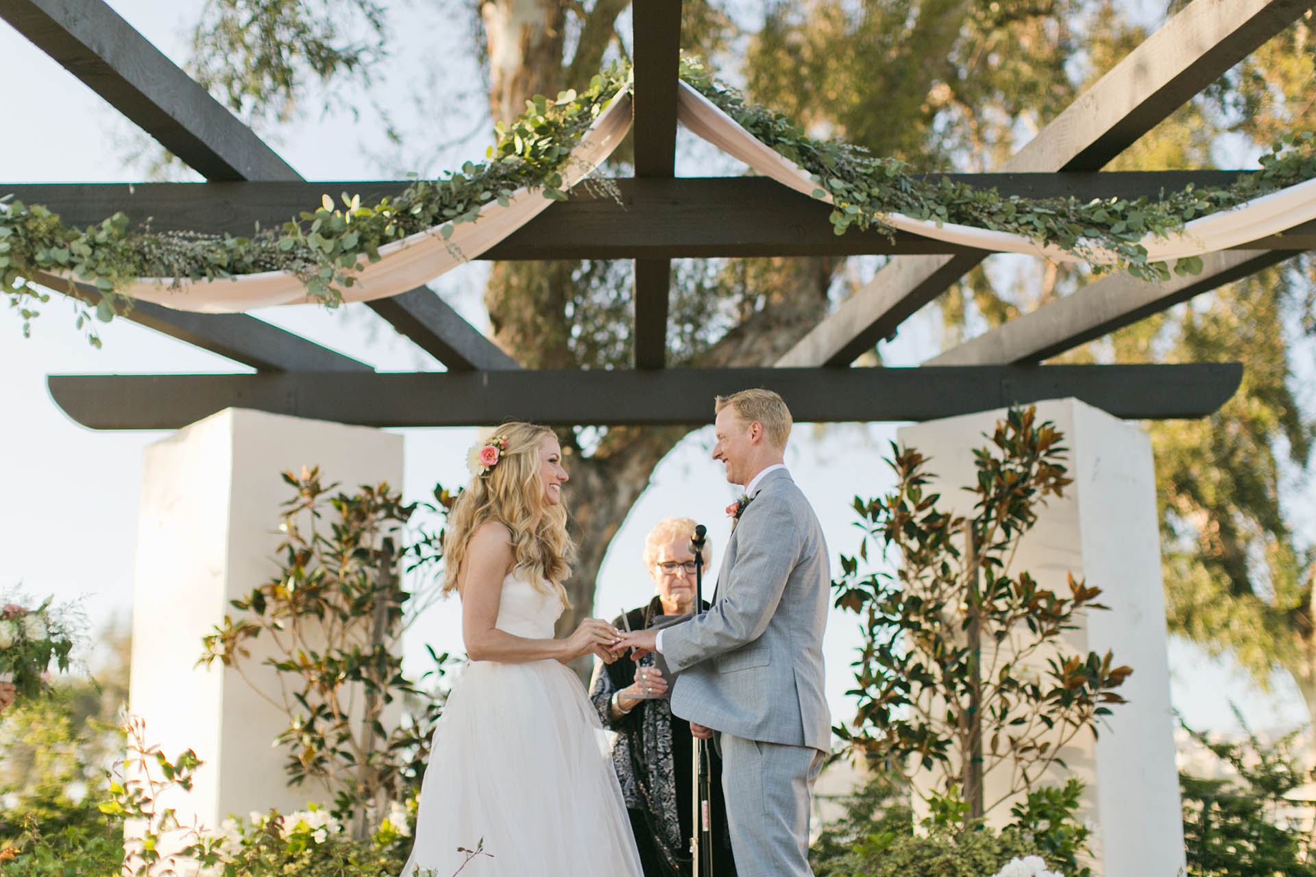 Ceremony pergola can be draped with florals or greenery