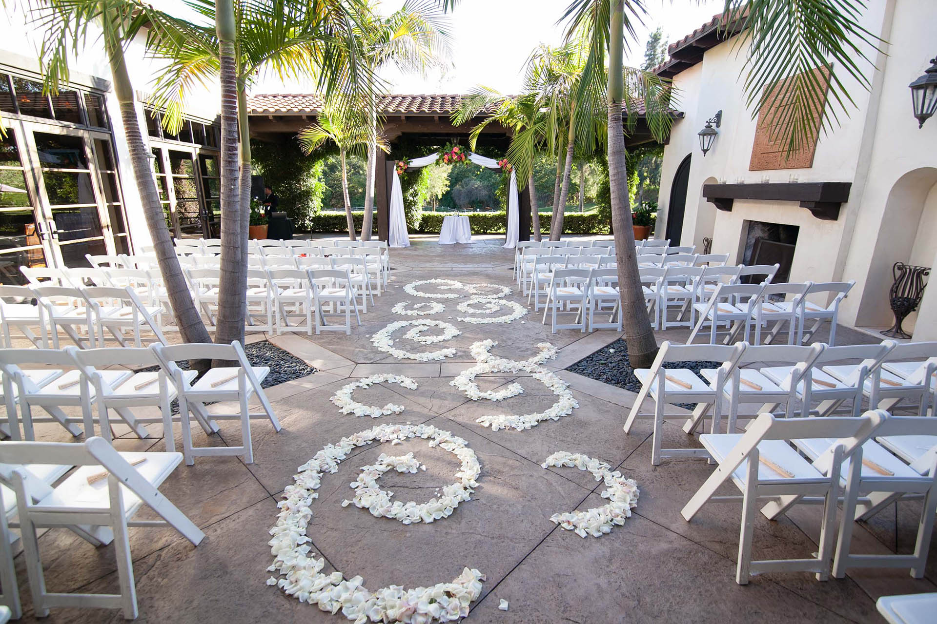 Spanish style ceremony site with floral carpet