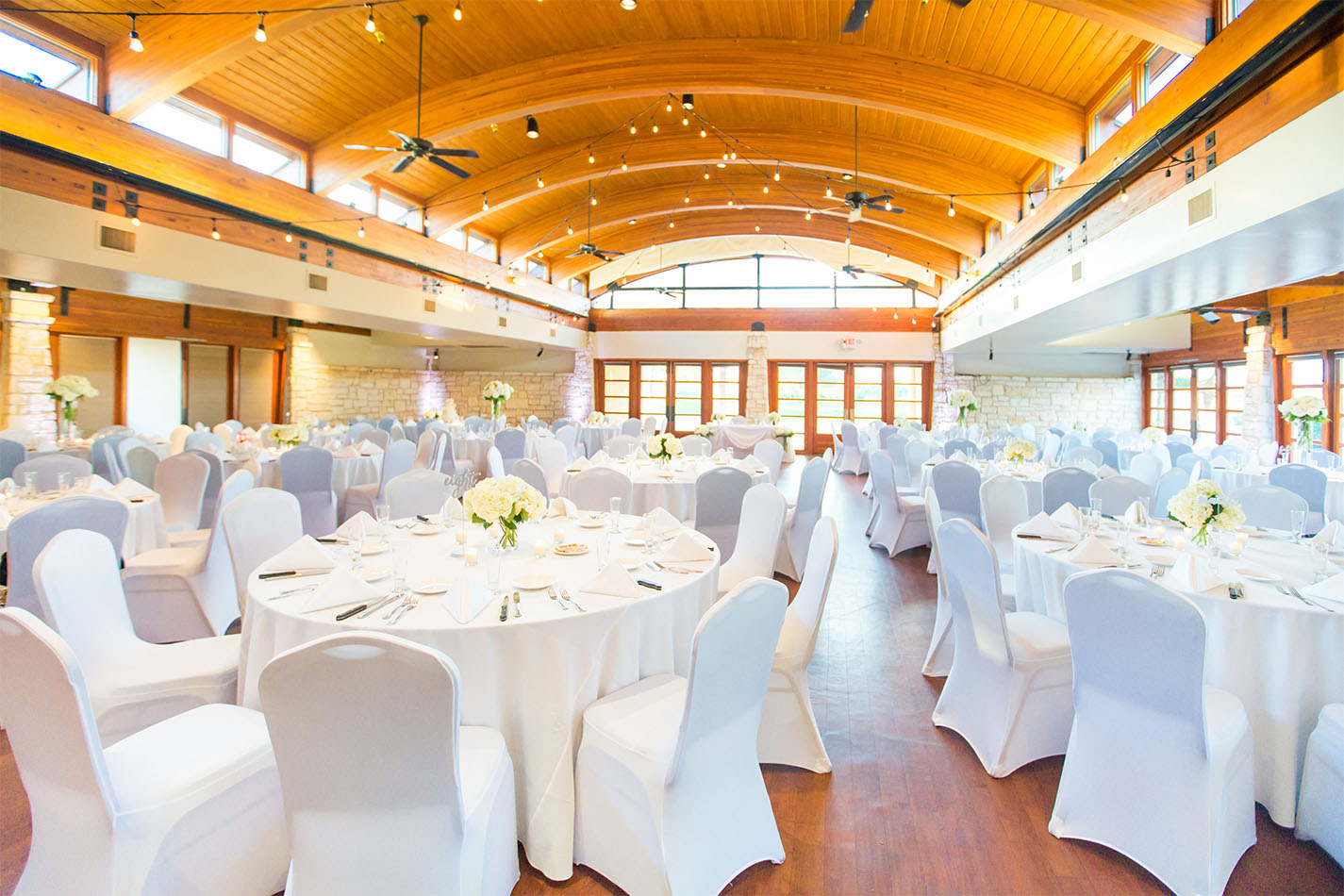 Grand ballroom with vaulted wood ceiling and expansive windows