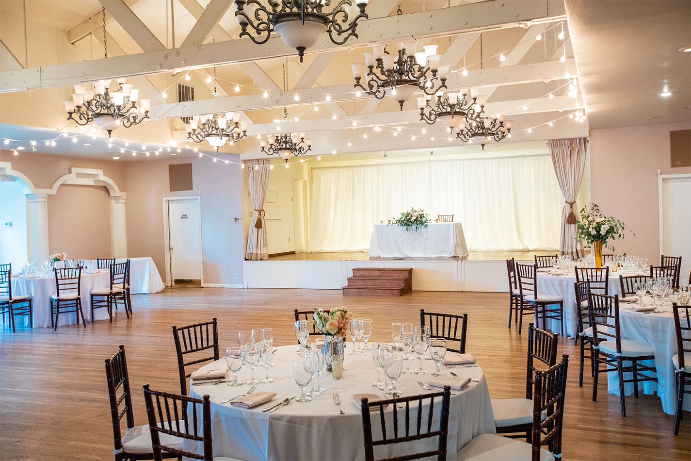 Empire Ballroom with hardwood floors and wood beam ceilings.