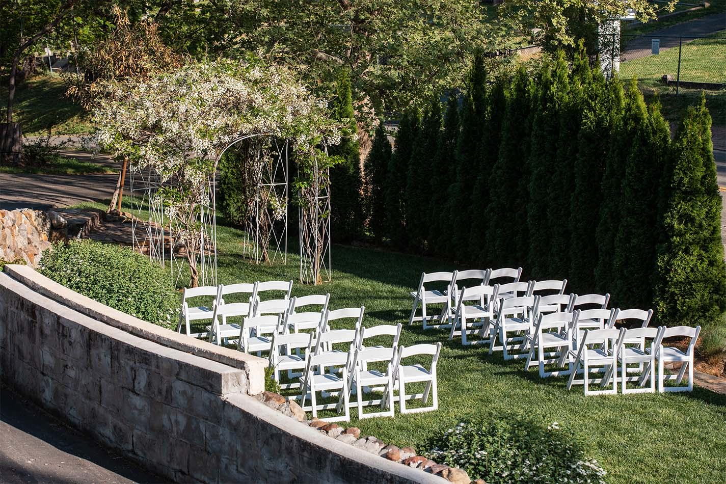 Outdoor wedding ceremony on the mansion lawn.