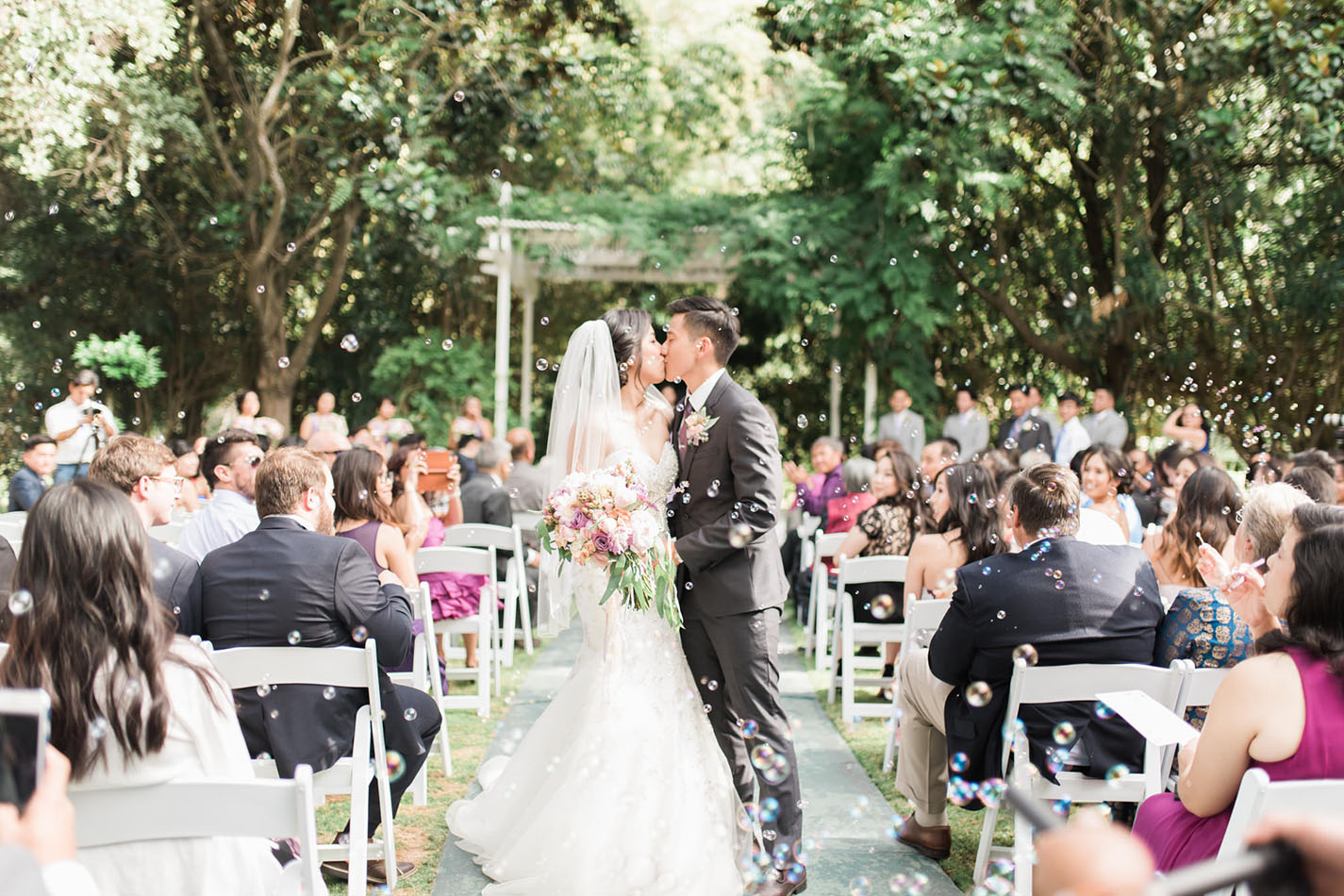 Whimsical garden wedding ceremony site.