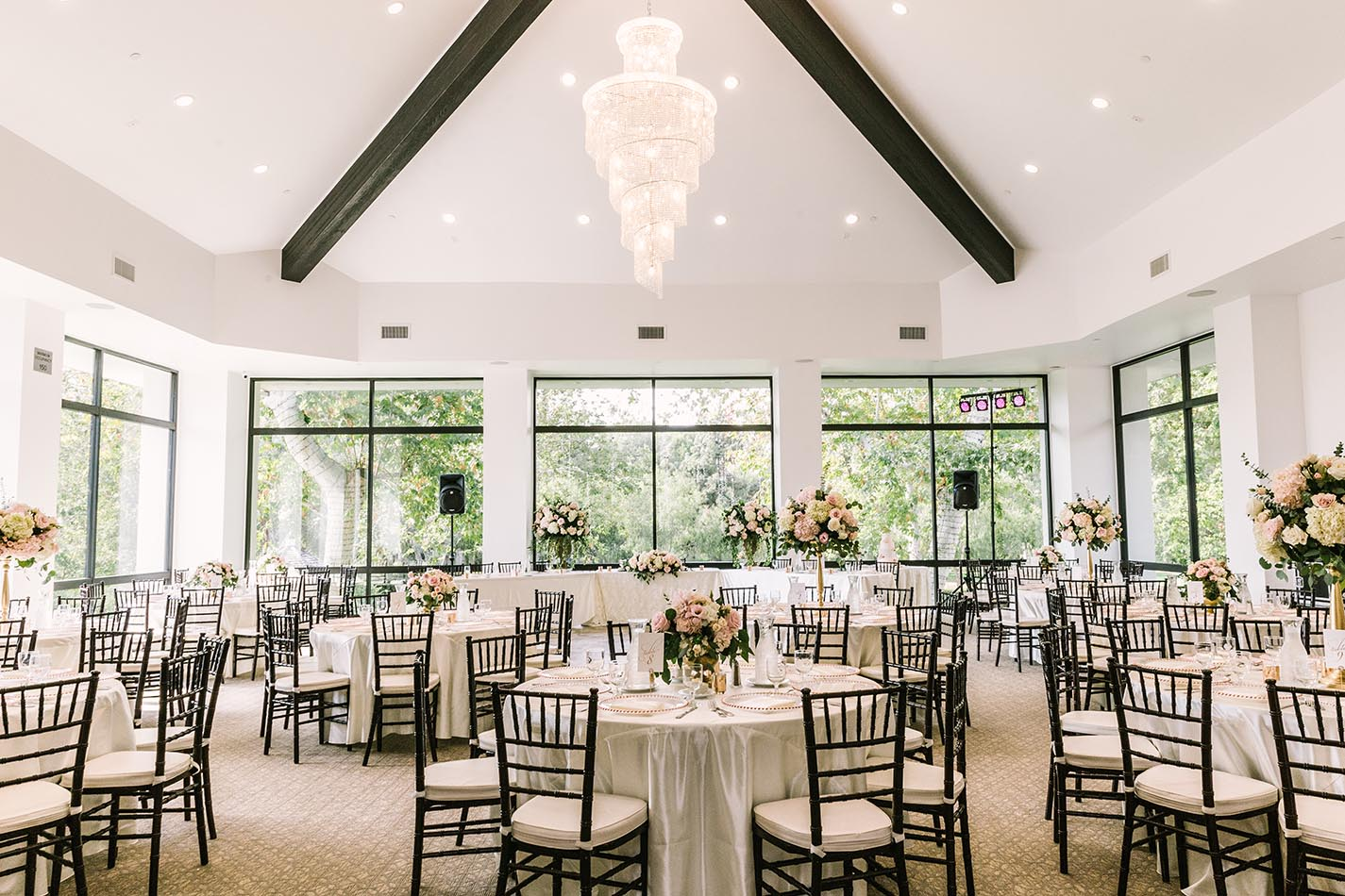 Your private reception is one-of-a-kind. Featuring vaulted ceilings, a stunningly luxurious crystal chandelier, floor-to-ceiling windows and incredible views, you'll find this to be a picture-perfect space for your celebration.