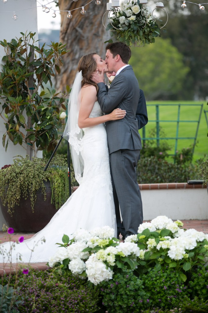 bride and groom first kiss as mr. and mrs.