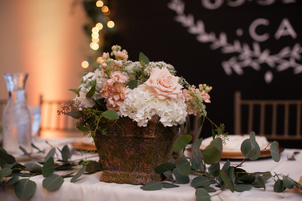 sweetheart table with beautiful flower bouquet floral arrangement