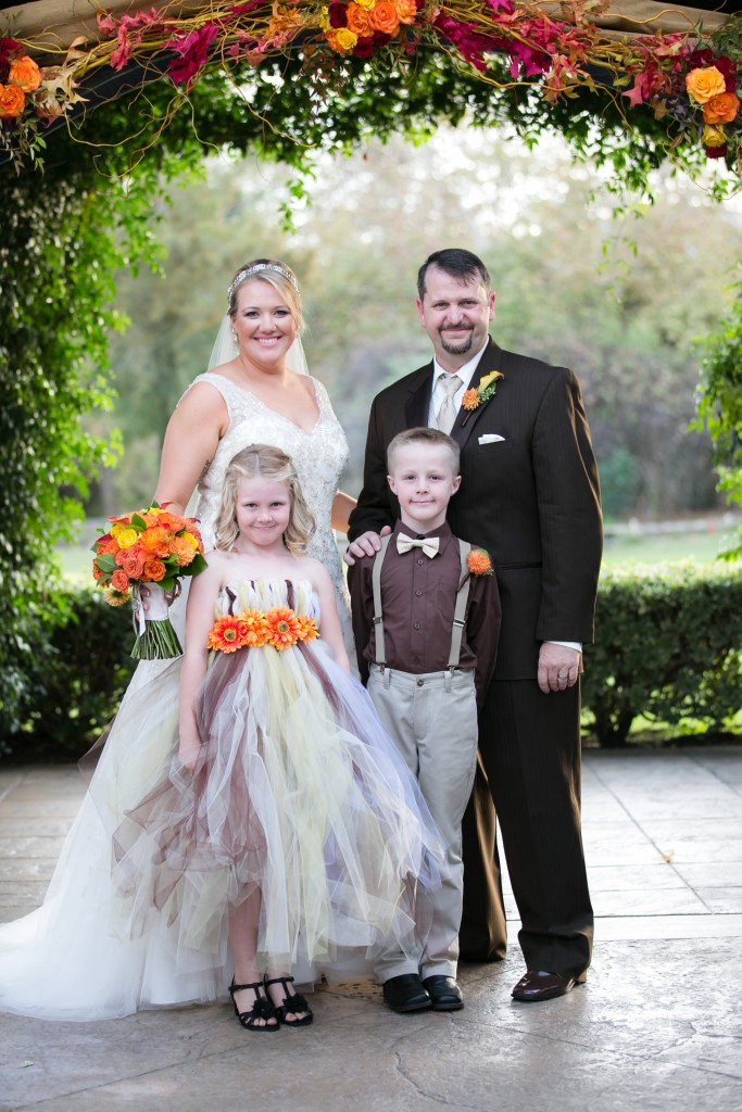 fall wedding bride and groom with kids family photo