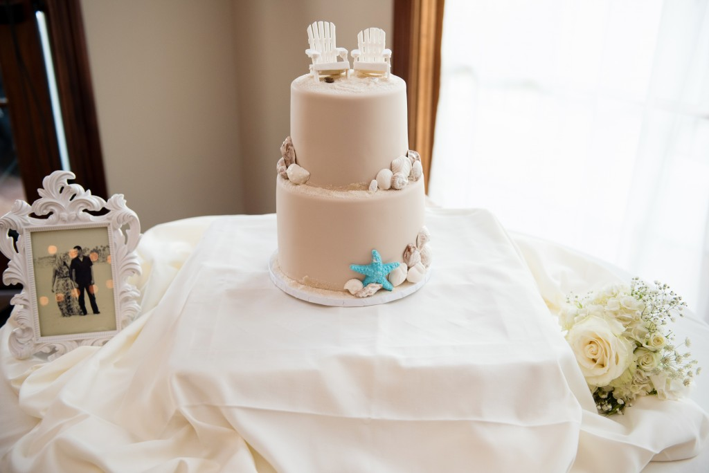 stunning beach wedding cake with sand cake topper