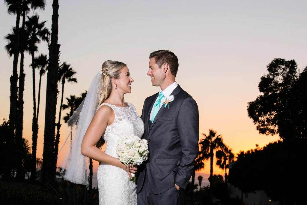 outdoor beach wedding with palm trees at sunset
