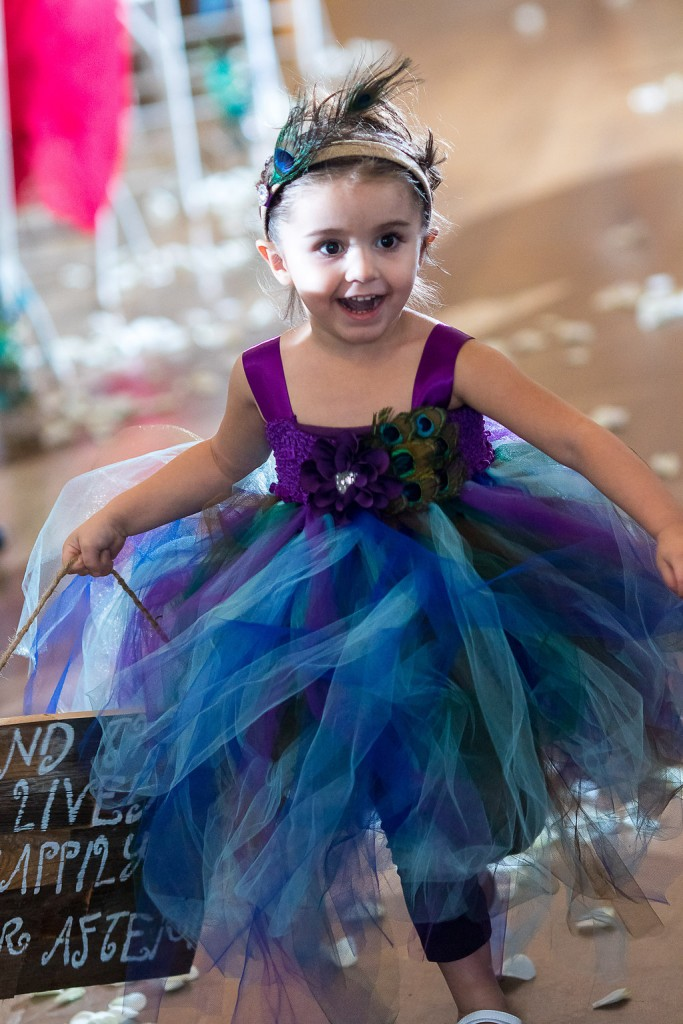 flower girl in peacock outfit