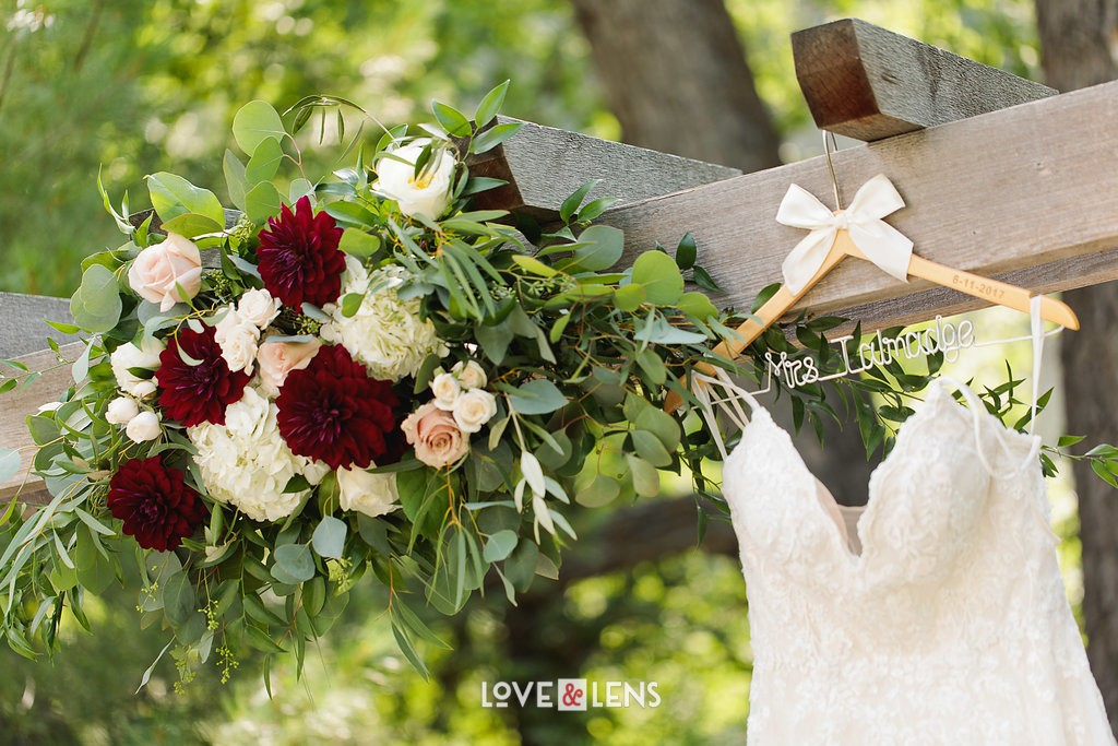 red and white wedding flowers ceremony arch