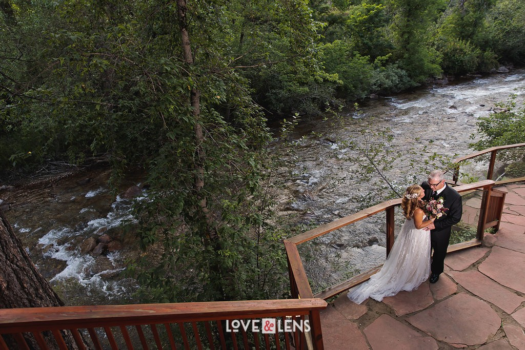 bride and groom by boulder creek