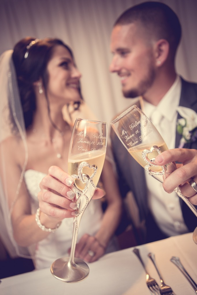 Wedgewood Weddings North Shore couple toasting