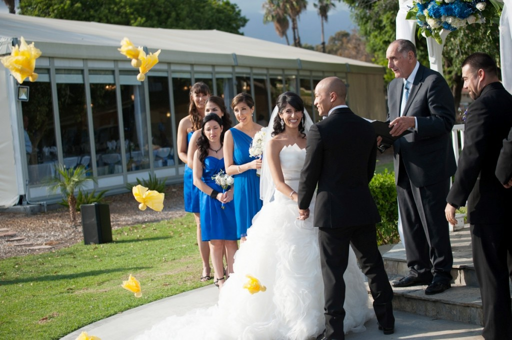 bride and groom at ceremony with yellow flags for sports theme wedding