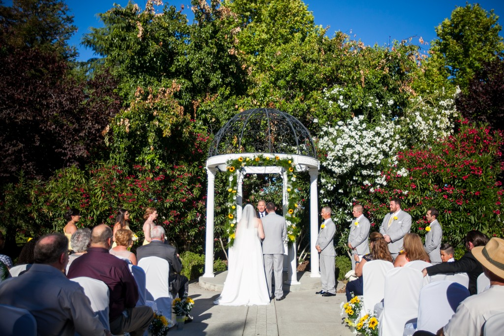 yellow wedding color scheme ceremony arch with sunflowers