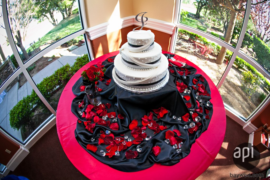 decorated red and black wedding cake table