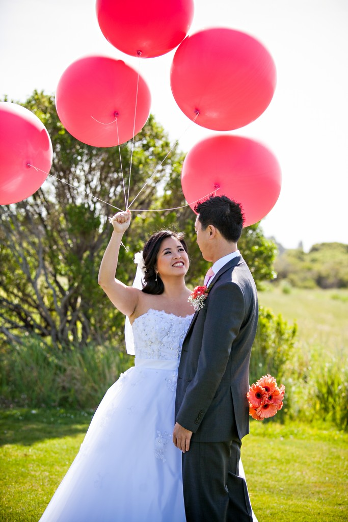 Wedgewood Weddings bride and groom with balloons